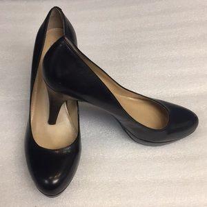 Black almond toe platform heel shoe by Marc Fisher